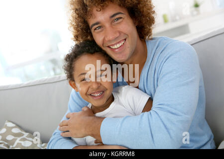 Father and child having fun together at home - Stock Photo