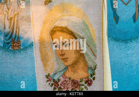 MEDJUGORJE, BOSNIA AND HERZEGOVINA - NOVEMBER 5:  the Blessed Virgin Mary embroidered on fabric in Medjugorje, a - Stock Photo