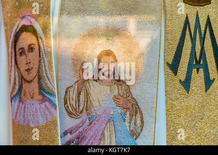 MEDJUGORJE, BOSNIA AND HERZEGOVINA - NOVEMBER 5:  Jesus Christ and the Blessed Virgin Mary embroidered on fabric - Stock Photo