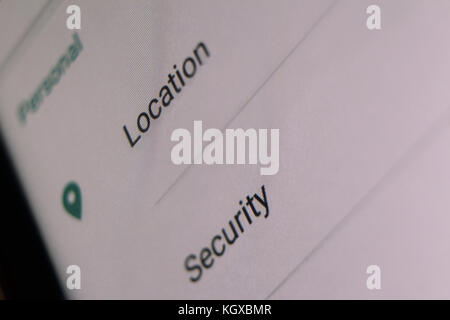 Location and security words on mobile menu screen, close-up - Stock Photo