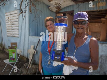 The Peces non-profit organization provides solar-powered lanterns for Puerto Rican residents during relief efforts - Stock Photo