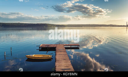 Small Dock and Boat at the lake, aerial view - Stock Photo