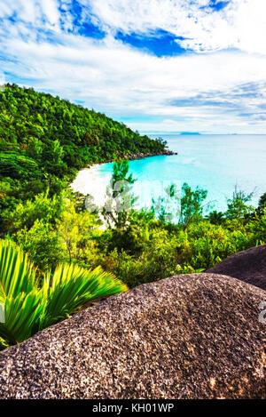 Hiking throug the jungle between the paradise beaches anse lazio and anse georgette, praslin, seychelles. Panorama - Stock Photo
