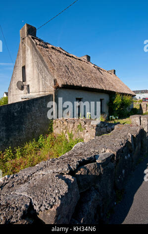Typical house with thatched roof near Galway, County Galway, Ireland - Stock Photo