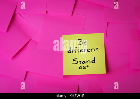 be different stand out text on yellow sticky note - Stock Photo