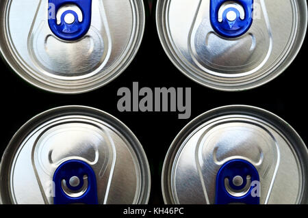 Soda cans seen from top isolated on black background - Stock Photo