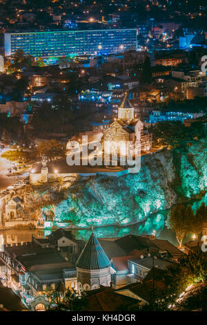 Tbilisi, Georgia. Night Evening Illuminated View Of Metekhi Church And Equestrian Statue Of King Vakhtang Gorgasali - Stock Photo