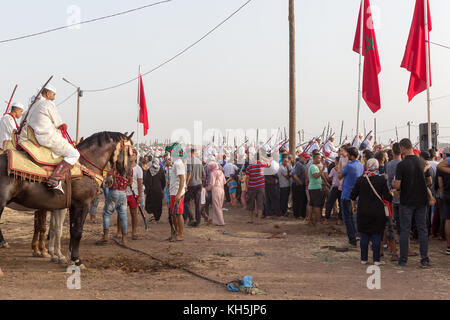 Fantasia is a traditional exhibition of horsemanship in the Maghreb performed during cultural festivals and to close - Stock Photo