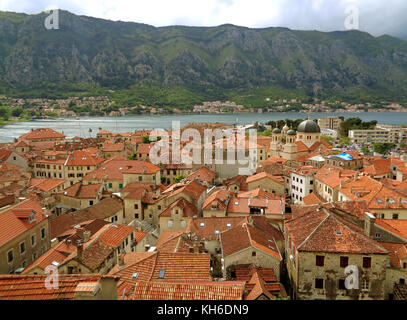 Aerial View of the Orange Color Tiled Roofs of Kotor Old City, Kotor Bay of Montenegro - Stock Photo