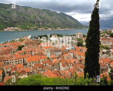 Impressive Panoramic View of Kotor Old City along the Shore of Kotor Bay, Kotor, Montenegro - Stock Photo