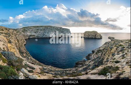 Panoramic view of Dwejra bay with Fungus Rock, Gozo, Malta - Stock Photo
