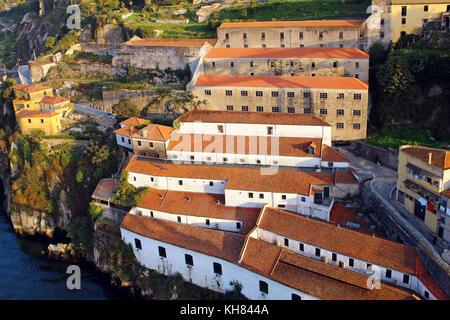 Vila Nova de Gaia old wine cellars on the bank of Douro river, Porto, Portugal - Stock Photo