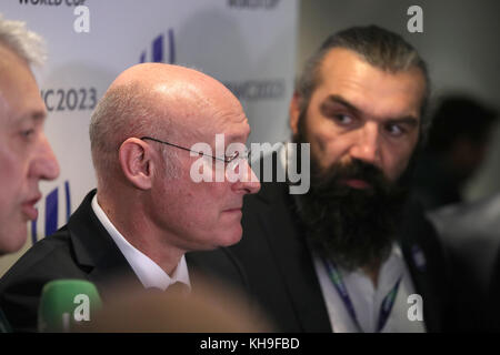 Sebastien Chabal (right) looks on as French Rugby Federation President Bernard Laporte (centre) and France 2023 - Stock Photo