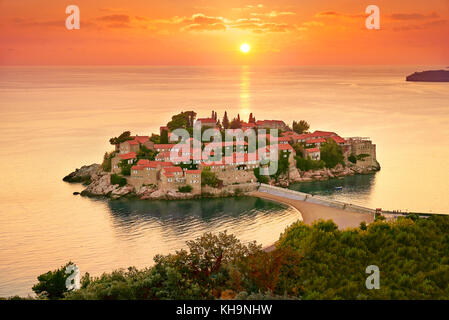 Sunset time at Sveti Stefan Island near Budva, Montenegro - Stock Photo