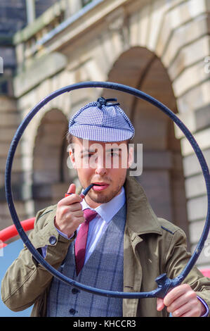 Male performer dressed as fictional character, private detective, Sherlock Holmes on the Royal Mile during the Edinburgh - Stock Photo