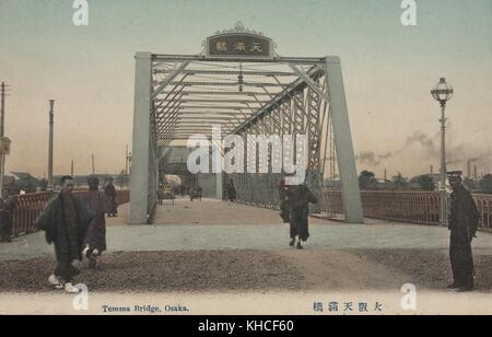 A postcard of the Temma Bridge, features a view through the bridge, people can be seen crossing both on foot and - Stock Photo