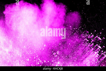 abstract pink dust explosion on  black background.abstract pink powder splattered on dark  background. Freeze motion - Stock Photo