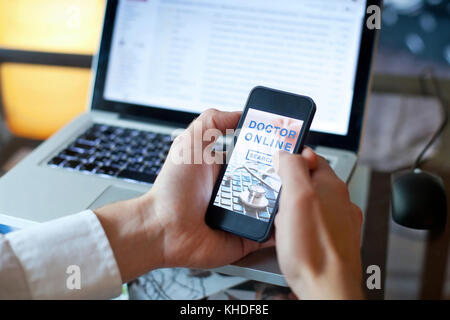 doctor online concept, mobile app for internet medical services on the screen of smartphone - Stock Photo