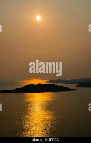 Sunset over Sveti Stefan Island, coast near Budva, Montenegro - Stock Photo