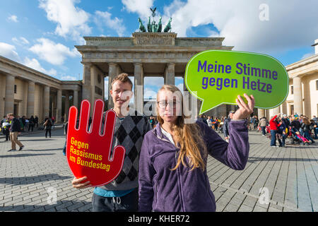 Two students with shield My vote against hate, against racism in the Bundestag, Anti AFD-Demo, Brandenburg Gate, - Stock Photo