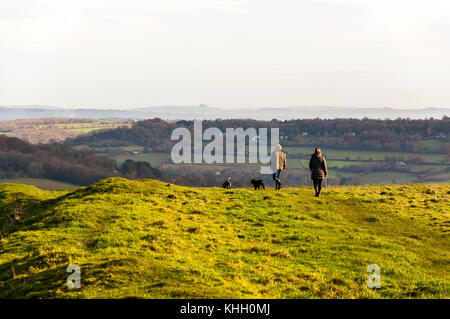 Little Solsbury Hill, Somerset, UK weather. 19th November 2017. People walking dogs on top of the landmark hill - Stock Photo