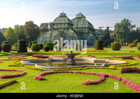 VIENNA, AUSTRIA - SEPTEMBER 11, 2016 : View of Palm House in Schönbrunn Palace Garden in Vienna, on bright sky background. - Stock Photo
