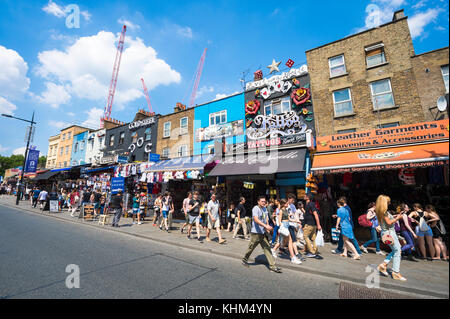 LONDON - JUNE 18, 2017: People exploring the bustling Camden Market area of London on sunny summer's day. - Stock Photo