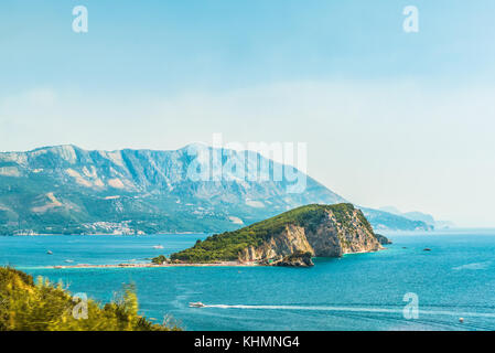 View of the island of St. Nicholas in the Gulf of the Adriatic Sea near the town of Budva, the famous tourist resort - Stock Photo
