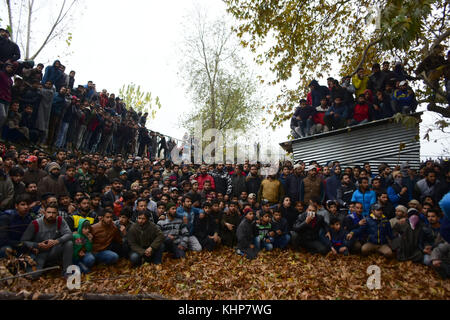 Srinagar, India. 18th Nov, 2017. Kashmiri people attend the funeral of top rebel commander Mugees Ahmad Mir in Parimpora - Stock Photo