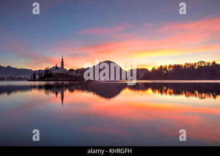Lake Bled and the small island in the middle at sunrise, Bled, Slovenia - Stock Photo
