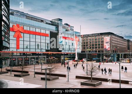 Helsinki, Finland - December 7, 2016: People Walking Near Original Sokos Hotel Presidentti And Kamppi Shopping Centre. - Stock Photo