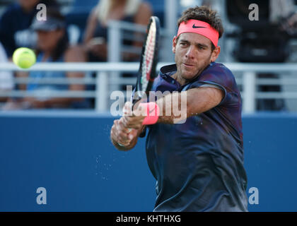 Argentinian tennis player JUAN MARTIN DEL POTRO (ARG) plays backhand shot during men's singles match at US Open - Stock Photo