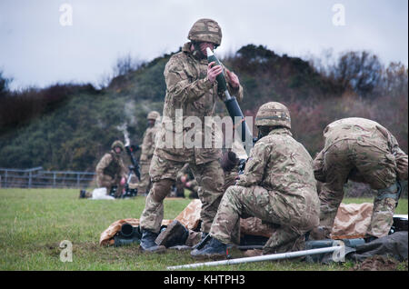 3 Rifles mortar line live firing on exercise - Stock Photo