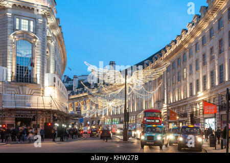 Christmas lights at dusk in Regent Street, Soho, City of Westminster, Greater London, England, United Kingdom - Stock Photo