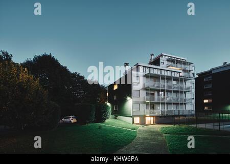 Apartment block at dusk, Chambery, Rhone-Alpes, France - Stock Photo