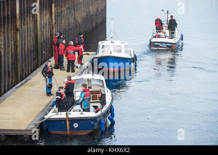 Cornwall Sea Cadets boarding small motor boats in preparation for a training exercise Falmouth Cornwall UK - Stock Photo