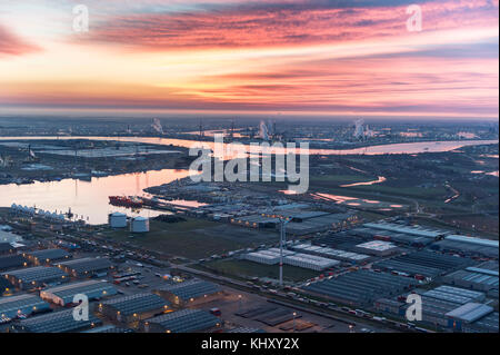 View on port of Antwerp before sunrise with Van Moer Logistics in the foreground - Stock Photo