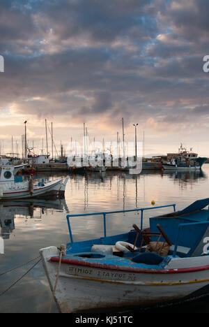Dramatic Sky at Sunset over fishing harbour in Chania, Crete - Stock Photo