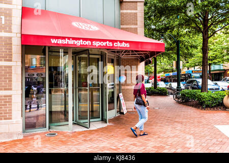 Silver Spring, USA - September 16, 2017: Woman walking by Washington Sports Clubs gym entrance in downtown area - Stock Photo