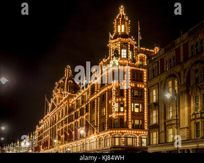 Harrods luxury department store illuminated at night, London, UK - Stock Photo