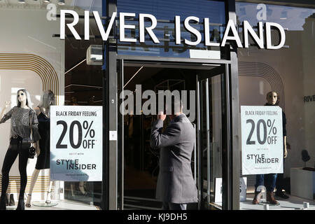 Wood Green. London, UK. 23rd Nov, 2017. A shopper walk past River Island store in Wood Green, North London as it - Stock Photo