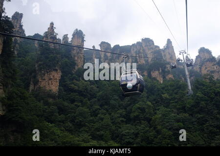 Cablecars going upwards at the Zhangjiajie National Forest Park in the Wulingyuan scenic region in China - Stock Photo