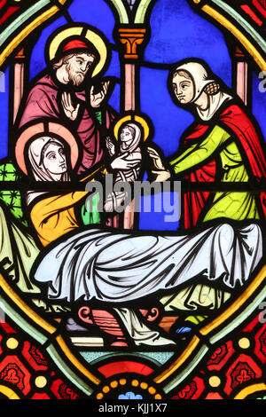 Saint-Pere church.  Stained glass window.  Birth of Virgin Mary.  France. - Stock Photo