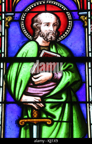 Saint-Pere church.  Stained glass window.  Paul the Apostle.  France. - Stock Photo