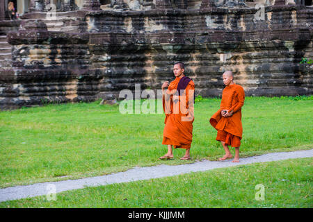 SIEM REAP , CAMBODIA - OCT 17 : Budhist monks at the Angkor Wat Temple in Siem Reap Cambodia on October 17 2017 - Stock Photo