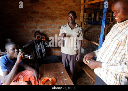 Dennis Openji owns a bar and drink shop in Katulikire. He received 3 loans from Kolping Uganda. Uganda - Stock Photo
