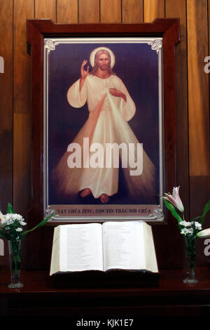 Church of the Sacred Heart of Jesus ( Nha Tho Tan Dinh ). Holy bible and Merciful  Jesus, I trust in you. Ho Chi - Stock Photo