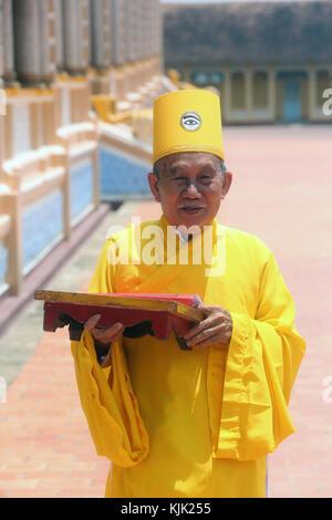 Cao Dai Holy See Temple.  Elederly priest.  Thay Ninh. Vietnam. - Stock Photo