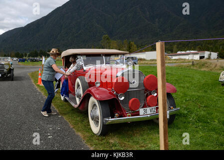 HAUPIRI, NEW ZEALAND, MARCH 18, 2017: Contestants in a vintage car rally hang out washing in a timed competition. - Stock Photo
