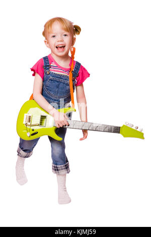 Little Girl playing guitar and singing isolated on white - Stock Photo